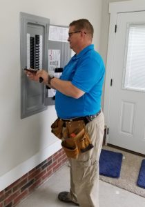 Erci Coates of Detailed Home Inspections inspecting the electrical panel